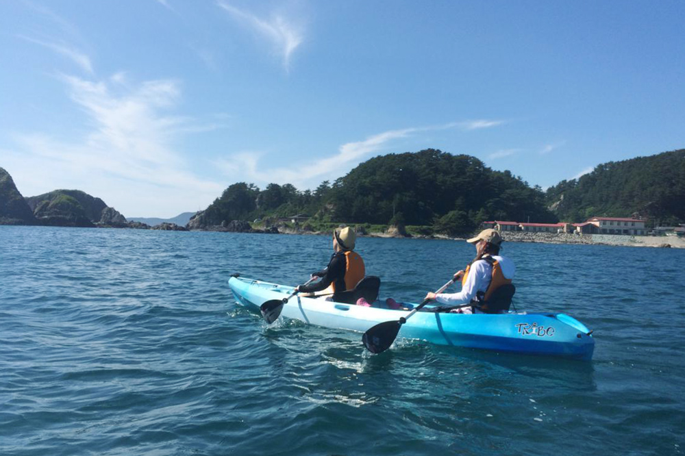Kayak between the giant crags, fantastic rock formations, and caves in the sea below the majestic peaks of Mount Shirakami